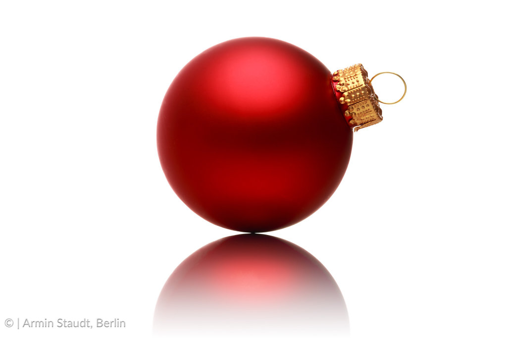 close up of a red christmas ball with reflection, isolated on white
