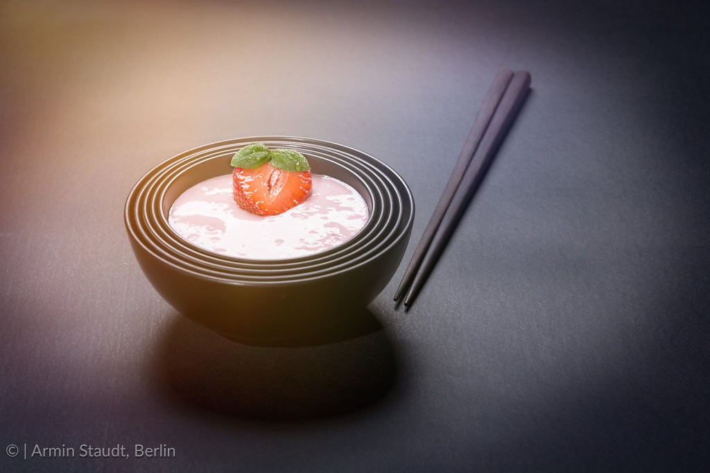 quark with strawberry in a black asian bowl