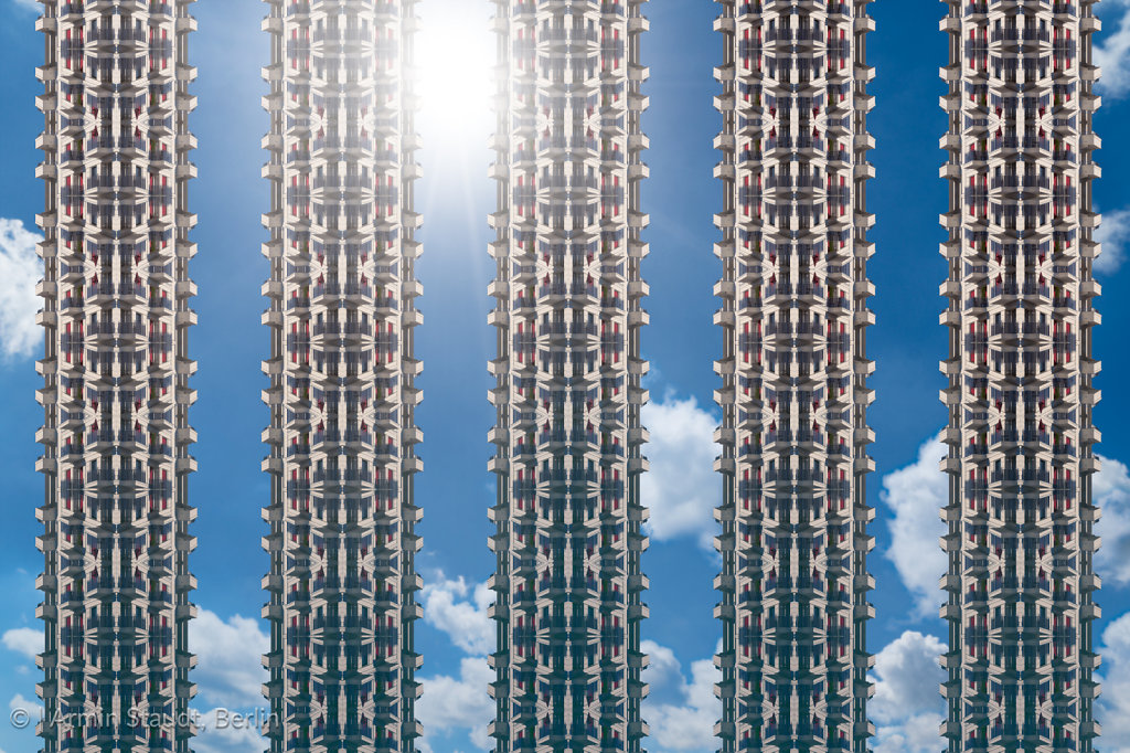 architectural pattern, the sun behind five artificial skyscrapers