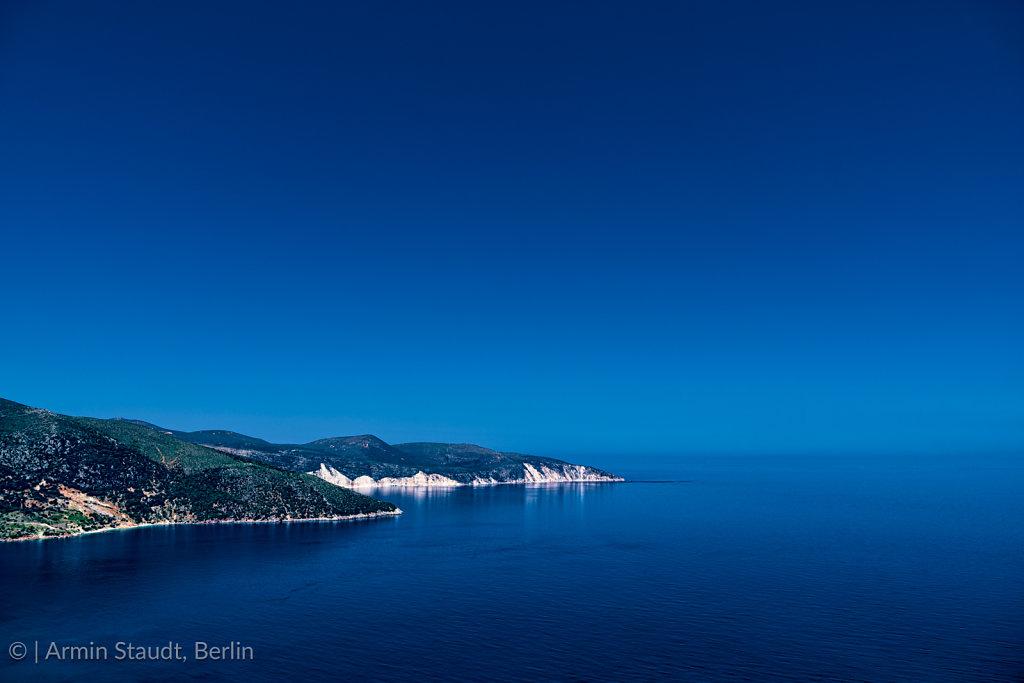 mediterranean landscape, promontory in the deep blue sea