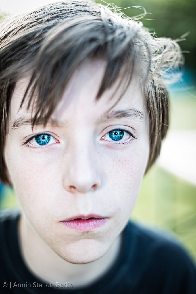portrait of a teenager boy with blue eyes