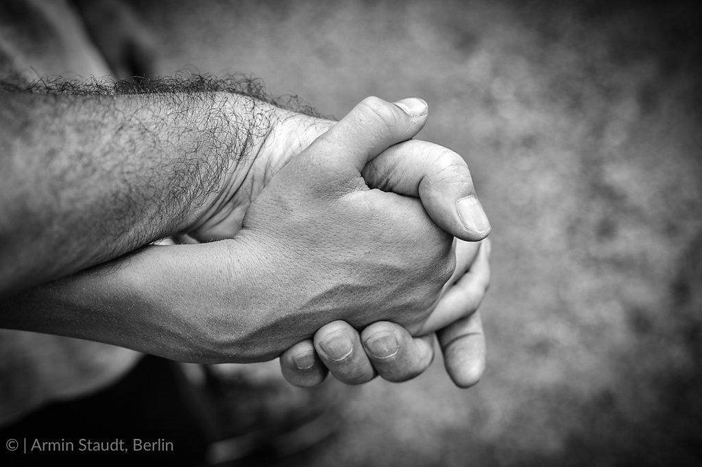 black and white sot of father and son's hands