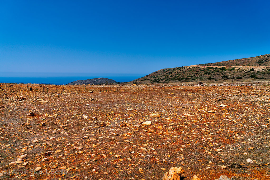 mediterranean landscape with red sand and stones