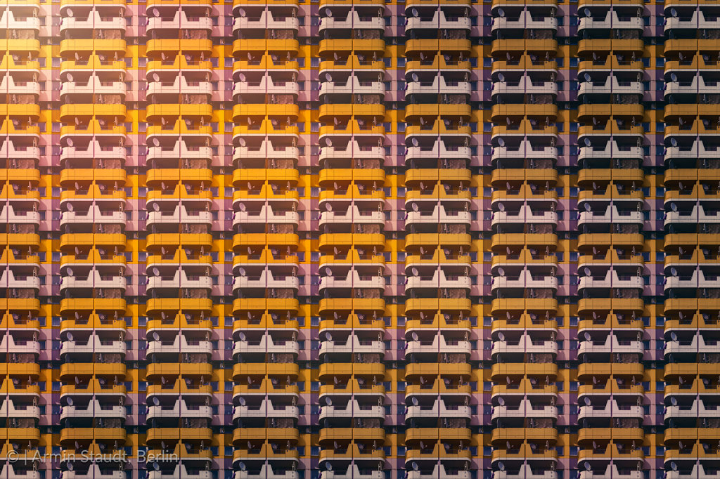 architectural pattern, facade with yellow balconies of a skyscraper