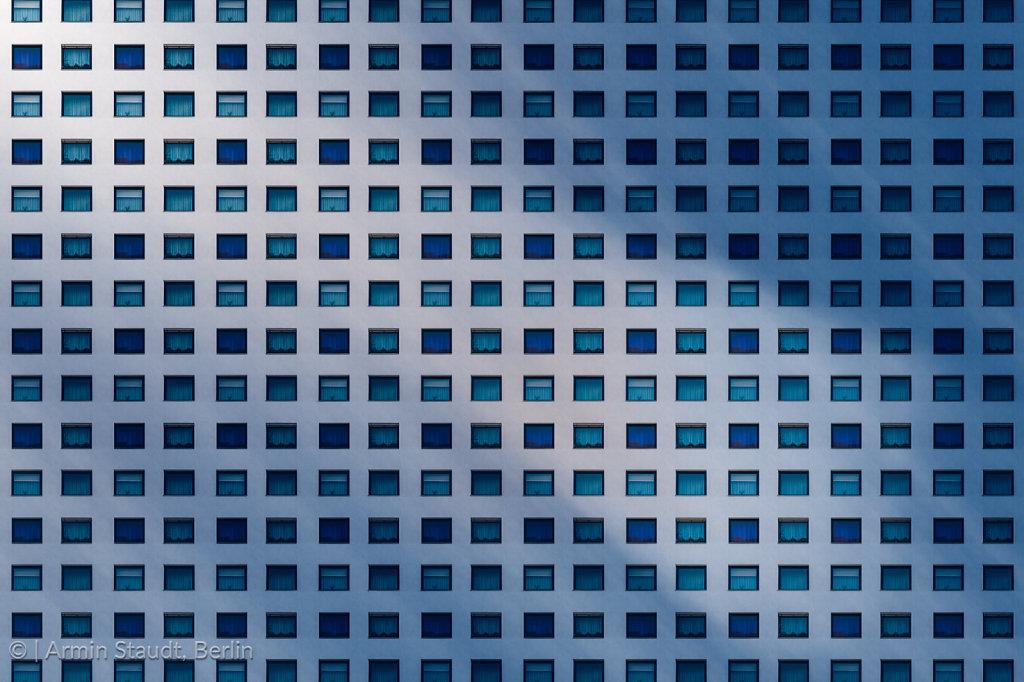 architectural pattern, dark window facade with mirroring sun